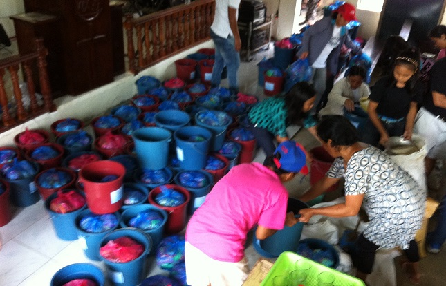 photo of relief supplies being packaged for distribution in Ilo ilo Philippines