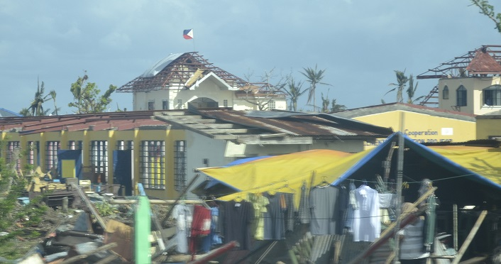 Philippine Flag flies proudly above the destruction photo