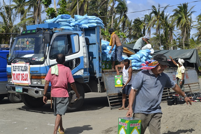 Unloading relief supplies in Leyte photo